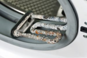 limescale on a washing machine element